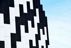 Domino abstraction. With black and white colors on blue sky Stock Image