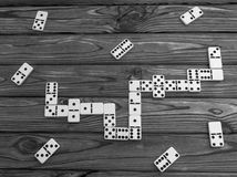 Domino pieces on the brown wooden table background Royalty Free Stock Image