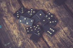 Domino. Black Domino on a old wooden background Royalty Free Stock Photography