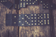 Domino. Black Domino on a old wooden background Stock Photography