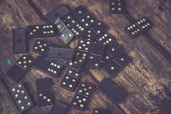 Domino. Black Domino on a old wooden background Stock Photo