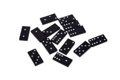 Domino chips with different numbers scattered on a white background. Isolate stock image