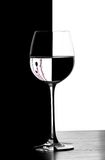Domino christmad wine glass. Domino wine glasses in backlight on the black and white contrast background with christmas decoration Royalty Free Stock Photography