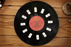 Domino Clock. Dominoes and an old record made into a clock stock images