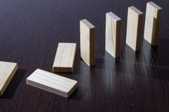 Domino cubes from maple on a dark table royalty free stock photos