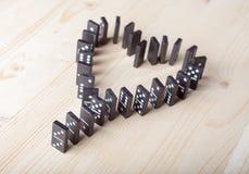 Domino dans la forme de la chaleur Photographie stock