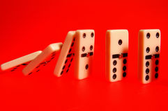 Domino,domino that coen on red background Stock Photos