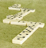 Domino. Es close-up on a background of rough cloth Stock Images
