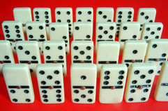Domino,dominos in a row and red background Stock Photography