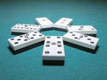 Domino Doubles. Double Dominoes ordered like a flower on a lighted table Stock Images
