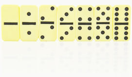 Domino doubles stood in order Royalty Free Stock Image