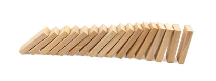 Domino effect. Wooden pieces falling in row Royalty Free Stock Photos