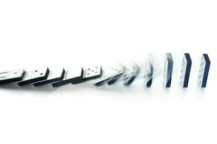 Domino effect. Falling dominoes - illustration of domino effect Stock Photo