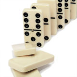 Domino effect. Isolated on white background Stock Images