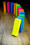 The domino effect of colorful wooden blocks Stock Photo