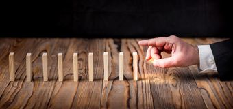 Domino Effect Concept, Businessman Starting Dominoes Chain Toppl Royalty Free Stock Photo