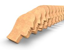 Domino effect concept with face shaped dominoes. Stock Image