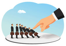 Domino effect. Corporate domino effect concept. A big hand is pushing down a businessman group Royalty Free Stock Photos