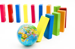 The domino effect of globe and colorful wooden blocks Stock Image