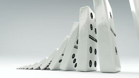 Domino effect from little to big. A chain of dominos of increasing size. stock video footage