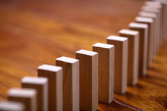Domino Effect. A lot of wooden block standing in a line. Domino Effect Concept Stock Photos