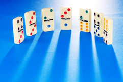 Domino effect with  pieces Stock Photography