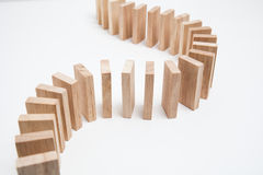 Domino effect - row of white dominoes Royalty Free Stock Photos