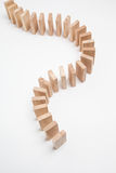 Domino effect - row of white dominoes Stock Photo