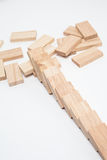 Domino effect - row of white dominoes on white background Royalty Free Stock Photo