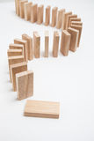 Domino effect - row of white dominoes on white background Stock Photo