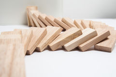 Domino effect - row of white dominoes on white background Stock Photography