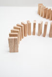 Domino effect - row of white dominoes on white background Royalty Free Stock Photography