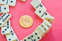 Domino effect shot. bitcoin destroyed financial anonymity. Bitcoin destroyed financial anonymity. Financial and economic chaos. Domino effect shot stock photos