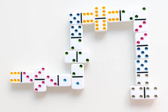 Domino effect shot. Look down for domino game. Dominoes falling in a row in front. Dominoes Game Pieces Isolated on Royalty Free Stock Image