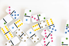 Domino effect shot. Look down for domino game. Dominoes falling in a row in front. Dominoes Game Pieces Isolated on Royalty Free Stock Photos