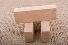 Domino en bois sur la toile de toile Image stock