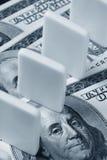 Domino en de dollar van de V.S. Stock Afbeeldingen
