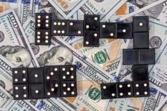 Domino en de dollar van de V Stock Foto's