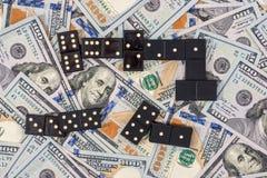Domino en de dollar van de V Stock Afbeeldingen