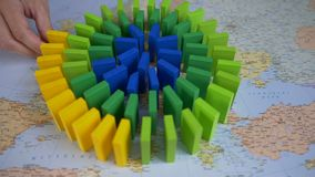 Domino Europe Map. Hand putting colorful wooden blocks in row on the Europe map stock video