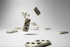 Domino fall. In white background Stock Photography