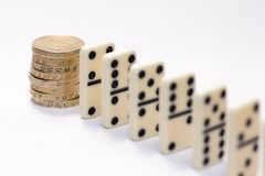 Domino falling on British economy Stock Photo