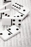 Domino finanziario Immagini Stock