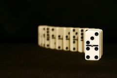 Domino from front. Front focused row of dominoes royalty free stock photo