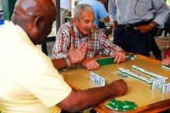 Domino Game in Calle Ocho, Miami. Friends enjoy a game of dominoes a the Domino Club in Calle Ocho, Miami stock images