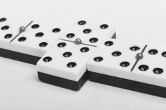 Domino game with pieces over a white background. Black, white Royalty Free Stock Photo