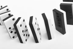 Domino game with pieces over a white background. Black, white Royalty Free Stock Photography