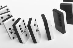 Domino game with pieces over a white background. Black, white Royalty Free Stock Photos