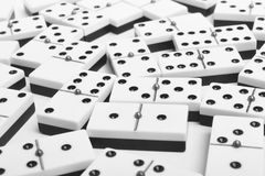 Domino game with pieces over a white background. Black, white Stock Photos