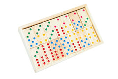 Domino game tiles in wooden case box. Isolated on white backgrou Royalty Free Stock Images